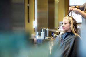 Talented stylist working on beautiful hair - Salon Services - Rapunzels Salon and Spa - Canmore